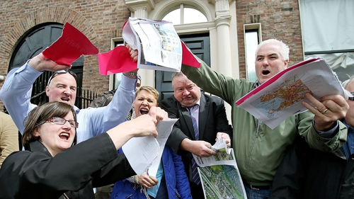 Protesters outside the Shelbourne Hotel ripped up copies of Allsops Irish property brochure