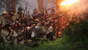 In the US, Confederate Civil War volunteers launch an evening attack during a three-day Battle of Gettysburg re-enactment