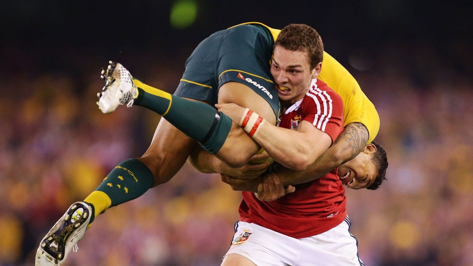 George North of the Lions lifts Israel Folau of Australia while carrying the ball during the second test in Melbourne