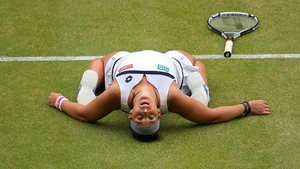 Marion Bartoli reacts to winning her semi-final against Kirsten Flipkens at Wimbledon