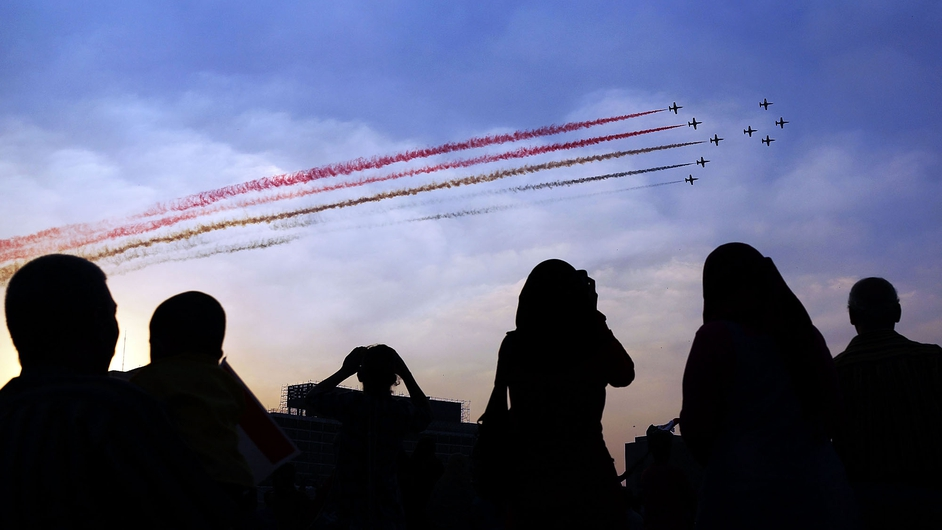 People celebrate as Egyptian military aircraft fly over Tahrir Square, the day after president Mohammed Mursi was removed from power