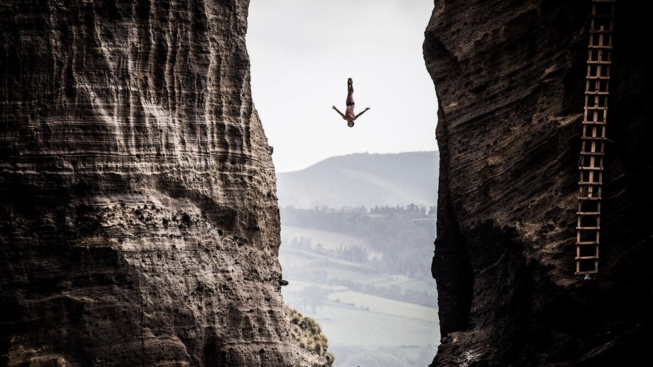 Jonathan Paredes of Mexico dives from the 27-metre platform during the Red Bull Cliff Diving World Series in the Azores, Portugal