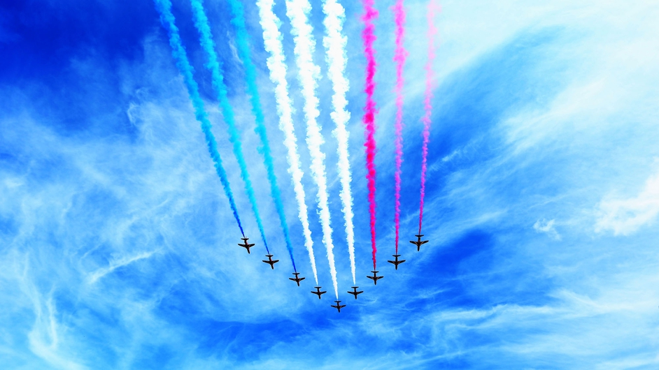 The RAF Red Arrows display team performed before the race at Silverstone