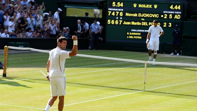 Novak Djokovic raises his fist in victory after firing a sublime winner to take the match