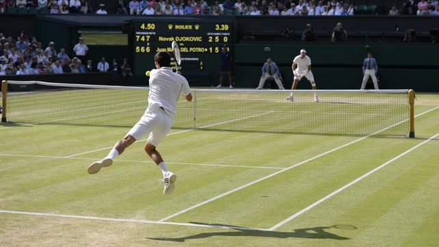 A lithe Novak Djokovic unleashes a viscous backhand against Juan Martin del Potro