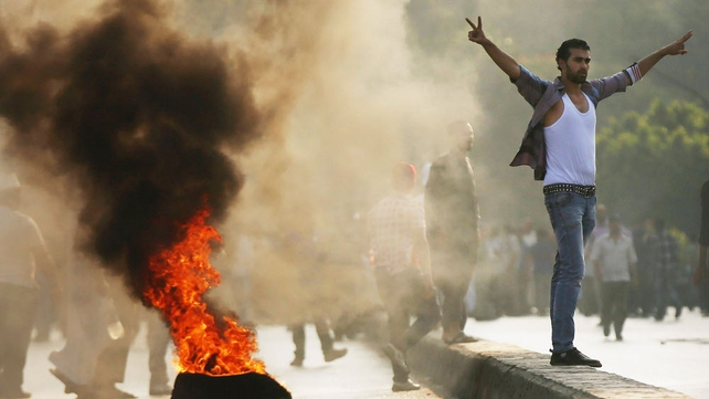 Supporters of Mohammed Mursi burn tyres on a bridge in Cairo in protest over his removal
