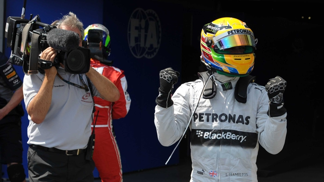 Lewis Hamilton shows his delight at earning pole position ahead of Sebastian Vettel