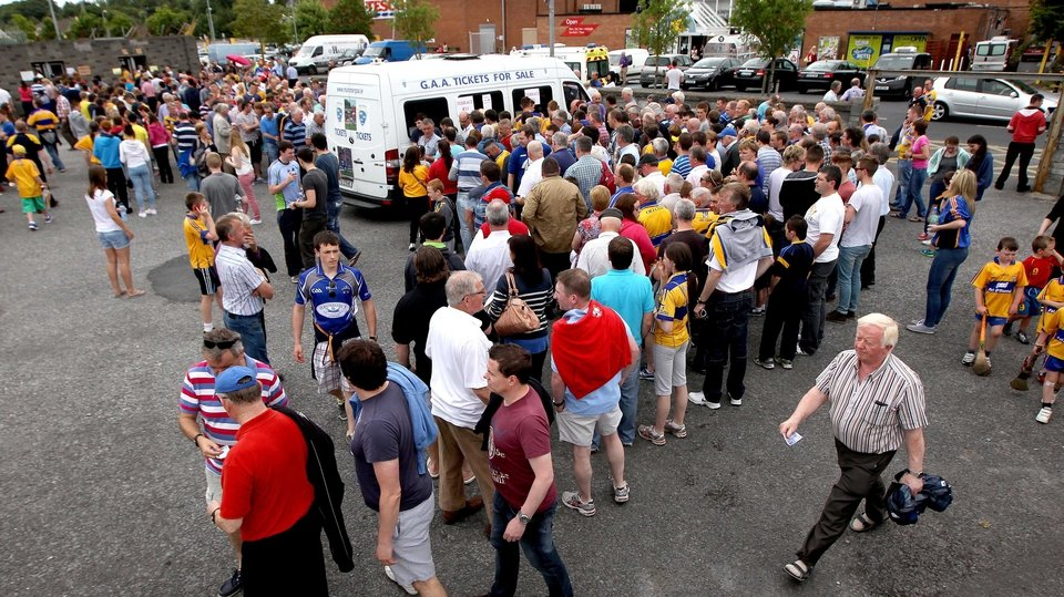 Fans swarm around a mobile ticket unit ahead of Clare v Laois