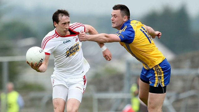 Roscommon's Donie Shine gets to grips with Tyrone's Colm Cavanagh