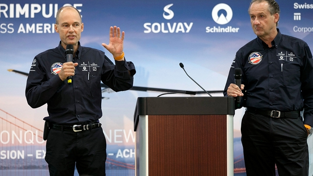 Solar Impulse Chairman and pilot Bertrand Piccard (L) and Solar Impulse CEO and pilot Andre Borschberg (R) speak during a news conference in June