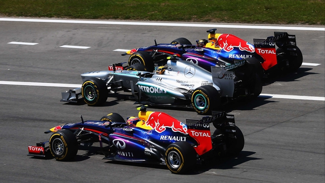 Sebastina Vettel (top)  races outside Lewis Hamilton (middle) and Mark Webber