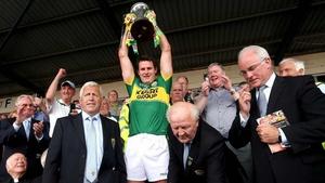 Eoin Brosnan holds the Munster SFC trophy aloft