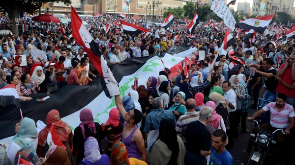 People protest in Alexandria, where 14 people died on Friday, clashes broke out again, but there were no immediate reports of casualties
