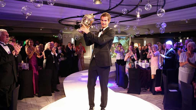 Andy Murray poses with the trophy during the Wimbledon Championships 2013 Winners Ball