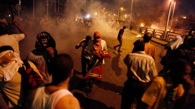 Egyptian supporters of the Muslim Brotherhood clash with police outside the elite Republican Guard base in Cairo