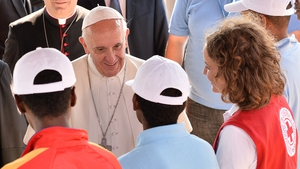 Francis greeted newly arrived migrants and said Mass on the island's sports field