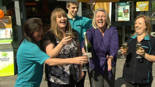 Staff at Mace in Beaumont celebrate selling the winning EuroMillions ticket