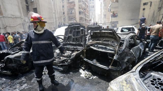 Dozens of vehicles were destroyed in the blast in the Bir al-Abed  neighbourhood