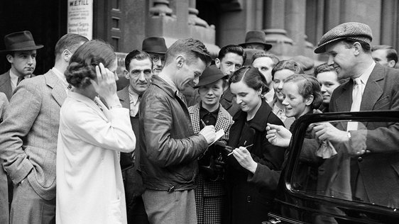 20th July 1938: American aviator Douglas Corrigan signing autographs in Dublin after his unauthorised flight across the Atlantic from New York. (Photo by Keystone/Getty Images)