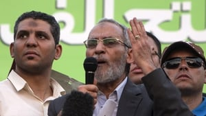 Mohamed Badie (C) had been in hiding since the crackdown against pro-Mursi supporters