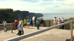 Coast to coast sunshine - people enjoying the fine weather and views from the Cliffs of Moher, Co Clare