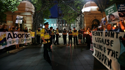 Rival crowds gather at Leinster House in Dublin as TDs Debate the Protection of Life During Pregnancy Bill into the night