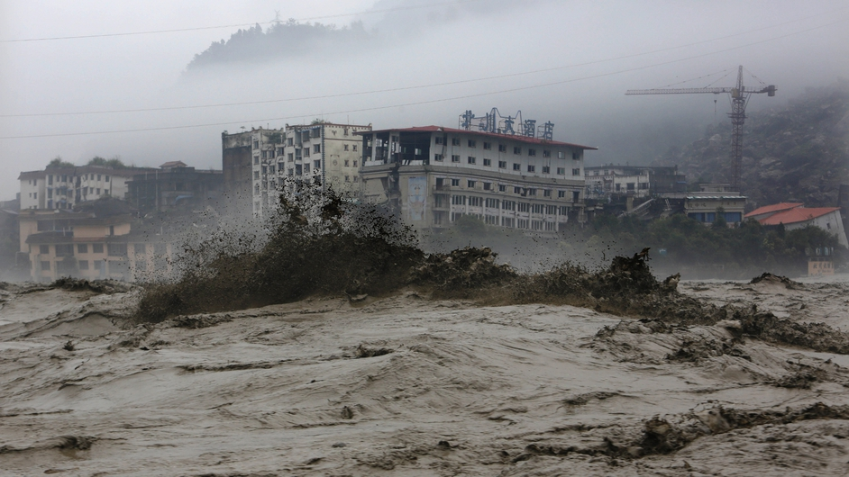 Flood waters sweep through Beichuan in southwest China's Sichuan province