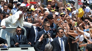 Pope Francis greets the crowds on the Italian island of Lampedusa