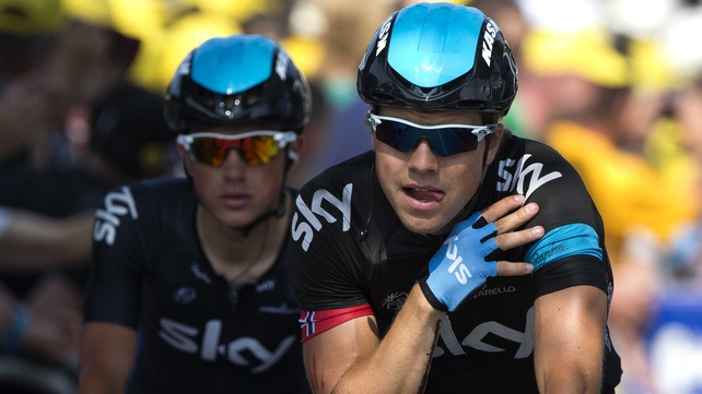 Edvald Boasson Hagen crosses the line holding his fractured shoulder