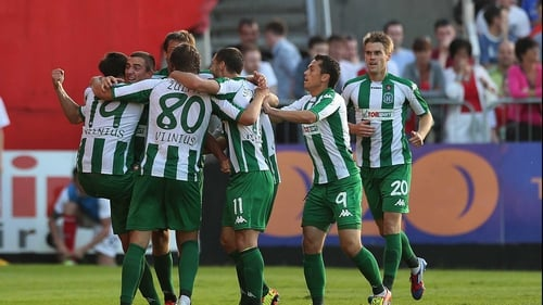Zalgiris players celebrate after scoring their crucial second goal at Richmond Park