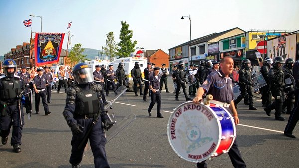 PSNI officers escort an Orange feeder parade on the Crumlin Road in Belfast