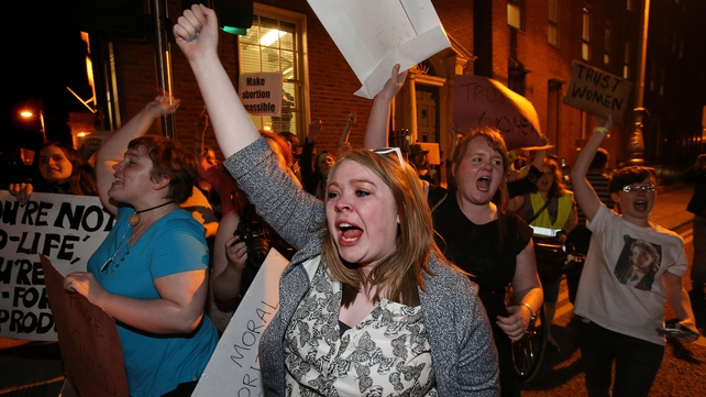 Demonstrators celebrated outside Leinster House following the final vote