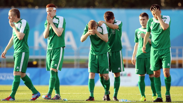 The Irish side show their disappointment after the penalty shootout