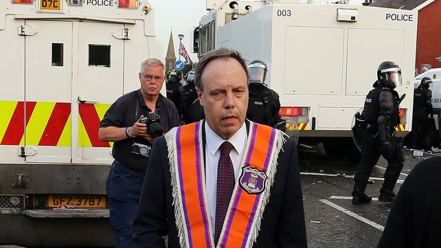 DUP MP Nigel Dodds had appealed for calm before he was knocked out by a missile