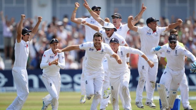 James Anderson of England (c) celebrates the final wicket of Brad Haddin of Australia and victory with team mates in the first Ashes test