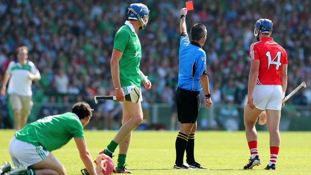 Referee James McGrath shows a red card to Patrick Horgan just before half-time in the Munster final