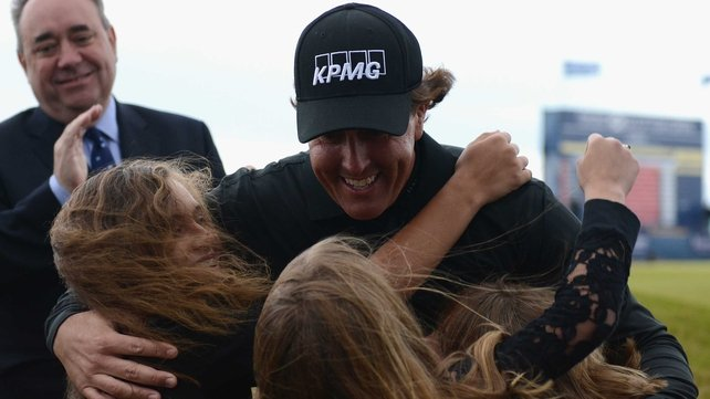 Phil Mickelson embraces his wife and daughter after winning at Castle Stuart