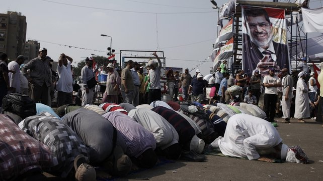 Supporters of Mohammed Mursi pray during demonstrations demanding his return to power