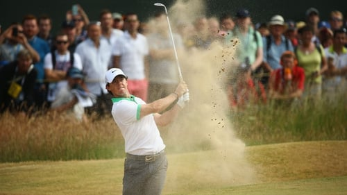 Rory McIlroy found the bunker on the first hole of his first round at Muirfield
