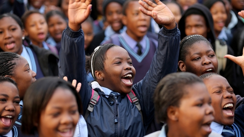 Schoolchildren sing 'Happy Birthday' at Mandela's former home in Soweto, Johannesburg
