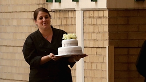 An unidentified woman arrives with a cake at the Mediclinic Heart Hospital in Pretoria