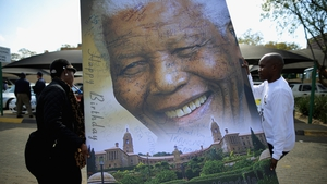 Workers carry a portrait of Mandela at the Mediclinic Heart Hospital