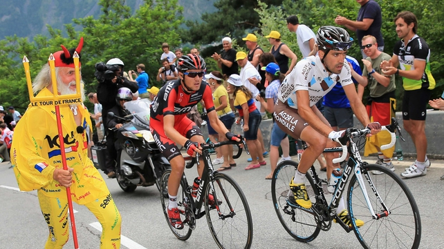 Christophe Riblon (r) and Tejay van Garderen (c) pass cycling ultra El Diablo