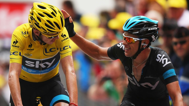 Richie Porte congratulates team-mate Chris Froome as he crosses the line
