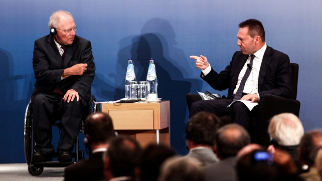 Wolfgang Schaeuble (left) said Greece should not 'continue this discussion' on debt