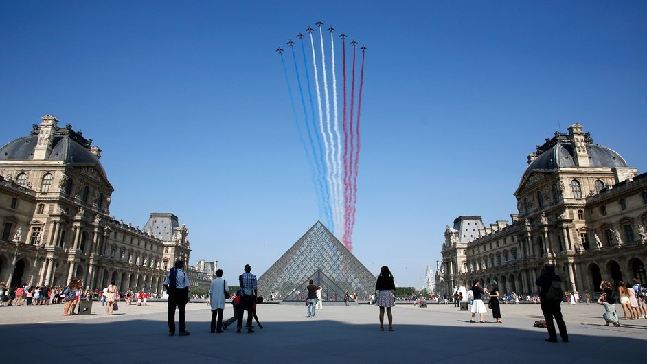 French Air Force jets fly over the Louvre in Paris as part of Bastille Day celebrations