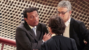 Francesco Schettino, captain of the Costa Concordia, speaks to his lawyers before his trial resumes in Grosseto, Italy