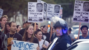 Protesters hold a peaceful rally in California after George Zimmerman was acquitted of second-degree murder and manslaughter in the Trayvon Martin case