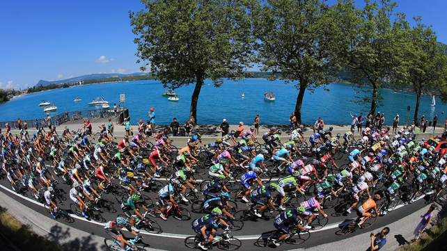 Riders make their way around Lake Annecy at the start of stage 20, a 125km road stage from Annecy to Annecy-Semnoz