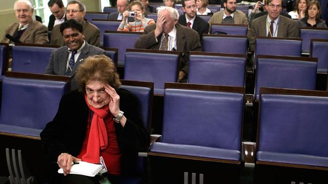 Helen Thomas, (front) waits prior to the White House daily briefing at the White House briefing room